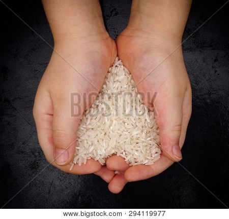Child Holds White Rice In His Hands. Rice In A Shape Of A Heart. Vignette.