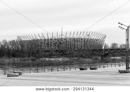 Warsaw, Poland - February 23, 2019: View Of Pge Narodowy And Vistula River In Black And White Colors