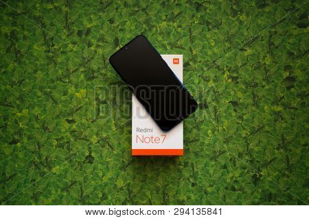 Braislava, Slovakia, April 8, 2018: Xiaomi Redmi Note 7 Smartphone On Green Leaves Background