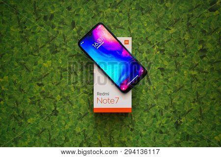Braislava, Slovakia, April 8, 2018: Xiaomi Redmi Note 7 Smartphone On Green Leaves Background