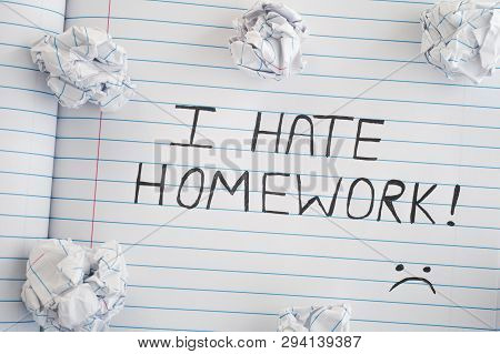 I Hate Homework. Phrase I Hate Homework On Notebook Sheet With Some Crumpled Paper Balls On It. Clos