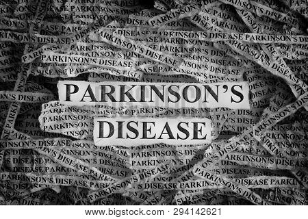 Torn Pieces Of Paper With The Words Parkinson's Disease