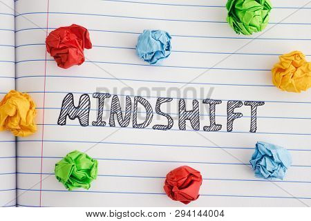 Mindshift. Word Mindshift On Notebook Sheet With Some Colorful Crumpled Paper Balls Around It. Close