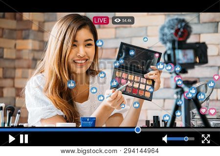 Young Beautiful Woman Recording Live Stream Video For Makeup And Cosmetics Business Purpose Online W