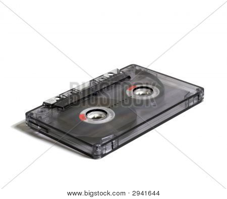 Black transparent audiocassette on a white background poster