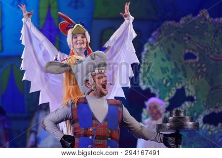 ST. PETERSBURG, RUSSIA - MARCH 25, 2019: Maxim Golovchanov as Donkey and Julia Asorgina as Rooster in the musical Town Musicians of Bremen during its press preview in Saint-Petersburg Music-Hall