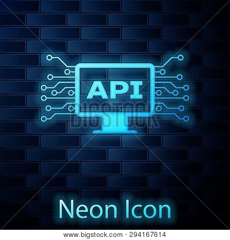 Glowing Neon Computer Api Interface Icon Isolated On Brick Wall Background. Application Programming