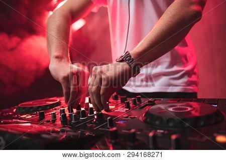 Dj Mixing At Party Festival With Red Light And Smoke In Background - Summer Nightlife View Of Disco