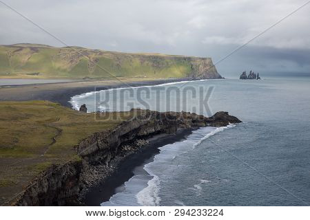The Rocky Winding Coast Of The Ocean Stretches To The Horizon, In The Background The Leaden Sky And