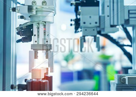 robotic and pneumatic piston unit on industrial machine,automation compressed air factory production