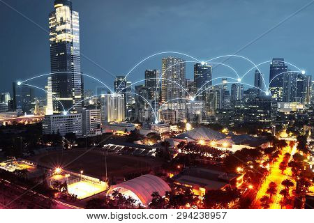 Modern City With Internet And Communication Network Over Night Scene Background
