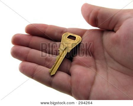 Old Key In The Palm Of A Hand