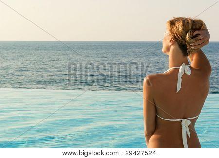 Sexy Woman In White Bkini Looking Far
