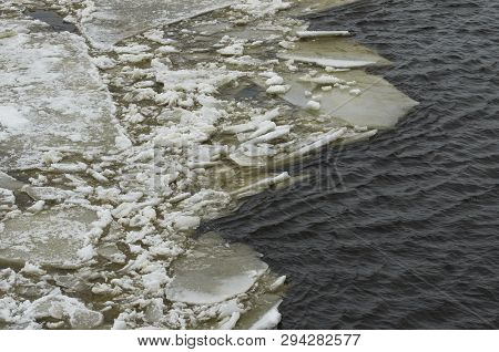 Edge of the ice field and the sludge on the river poster
