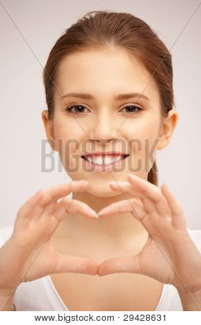bright picture of happy woman making heart gesture