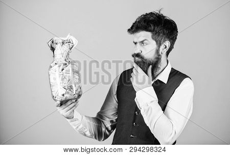 Financial success. Businessman with his dollar savings. Richness and wellbeing. Security and cash money savings. Banking concept. Man bearded guy hold jar full of cash savings. Establish your budget poster