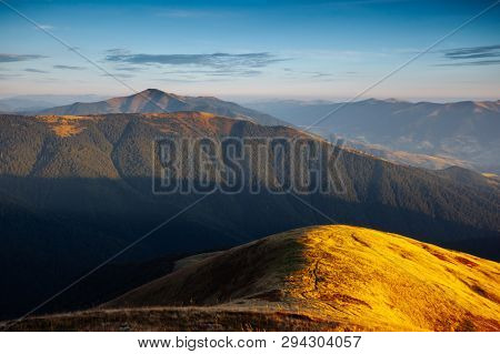 Majestic panorama of mountains in evening light. Location place Carpathian mountain, Ukraine, Europe. Scenic image of National Park, natural reserve. Exotic summer scene. Discover the beauty of earth.