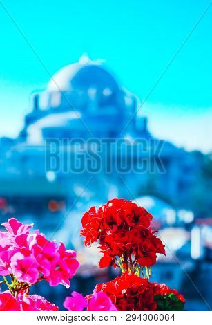 Blurred Arabic Mosque Background. De Focused Muslim Architecture Monument, Blue Sky And Flowers. Ist