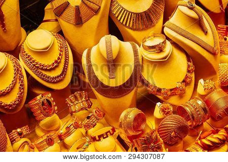Jewellery Shop Showcase With Golden Chains, Necklace And Bracelets. Expensive Luxury Lifestyle Conce