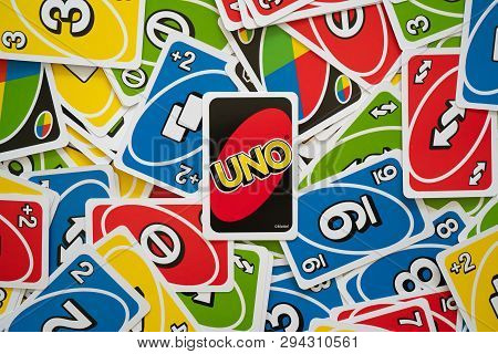 6 April 2019, Wuhan China : Uno Game Cards Scattered All Over The Frame And One Card Showing The Rev