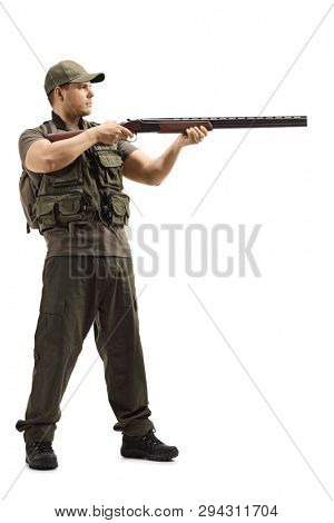 Full length shot of a hunter standing and aiming with a shotgun isolated on white background