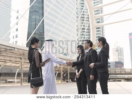 Businessman Arabic With Business People Making Handshake Agreement. Concept Partner To Business.
