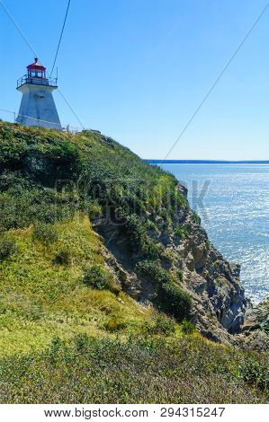 View of the Cape Enrage lighthouse, in New Brunswick, Canada poster
