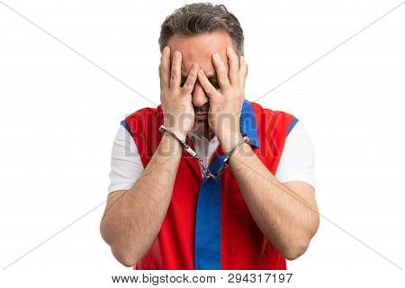 Guilty Supermarket Or Hypermarket Male Employee Covering Face With Handcuffed Hands Isolated On Whit