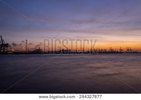 Long Time Exposure Of Container Port In Hamburg, Germany At Night