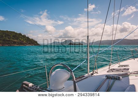 Sailboat Sailing On A Warm Beautiful Day In The Whitsunday Islands On The Great Barrier Reef In Aust