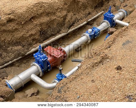Image Of New Water Pipe In The Ground