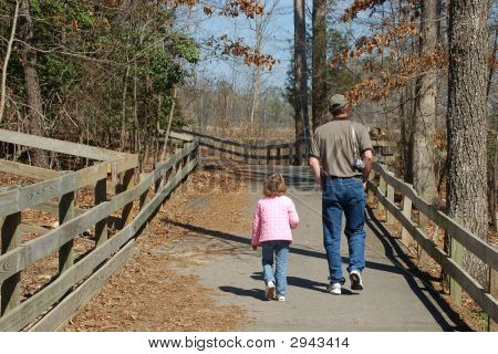 Father And Daughter Enjoy Walk