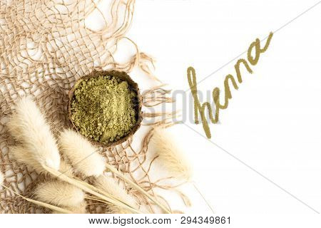 Henna Powder For Dyeing Hair And Eyebrows And Drawing Mehendi On Hands, Isolate With Green Palm Leaf