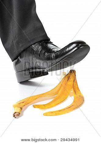Businessman Foot About To Slip And Fall On A Banana peel