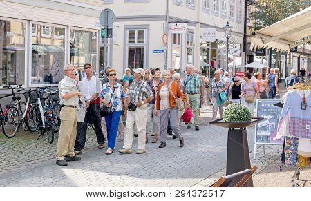 Niedersachsen, Germany August 26, 2015: A Party Of Tourists Being Shown Around A Town By Their Tour