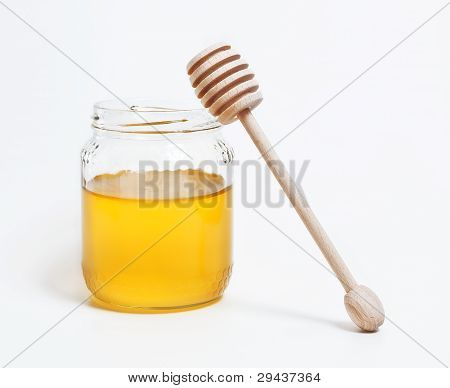 jar of honey with wood spoon