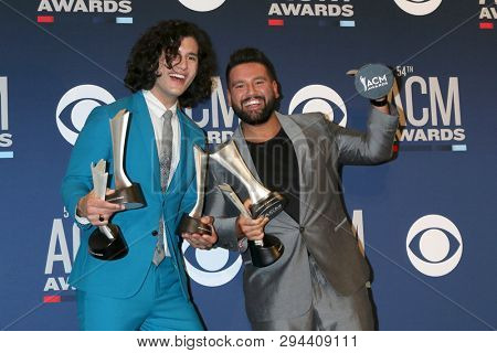 LAS VEGAS - APR 7:  Dan Smyers, Shay Mooney, Dan + Shay at the 54th Academy of Country Music Awards at the MGM Grand Garden Arena on April 7, 2019 in Las Vegas, NV