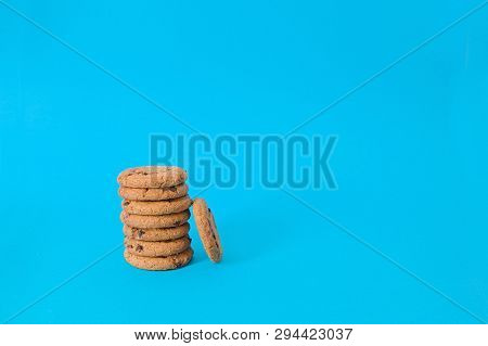 Cookies On Blue Background. Oatmeal Cookie With Pieces Of Chocolate