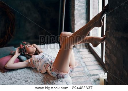 Happy Young Woman Lying On Bed After Wake Up Enjoying Morning. Careless Concept