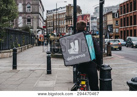 London, Uk - April 6, 2019: Deliveroo Delivery Driver On A Street In East London. Deliveroo Is A Bri