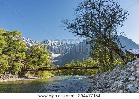 Idyllic Landscape Of Hotaka Mountains And Kappa Bridge In Kamikochi, Nagano, Japan