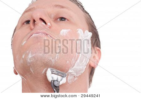 Male Wet Shaving With A Razor