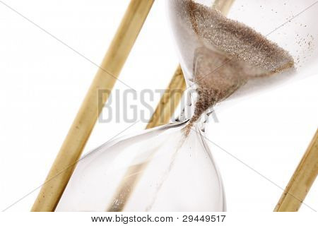 Close up of hourglass isolated on white background, selective focus