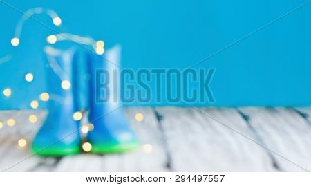 Abstract Of Blurred Blue Rain Boots