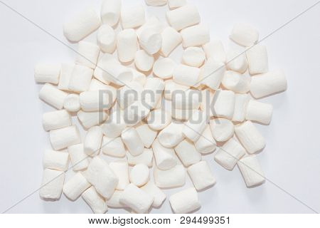 Top View Of Fluffy White Marshmallow Isolated On White Background. Sweet Food. Background Or Texture