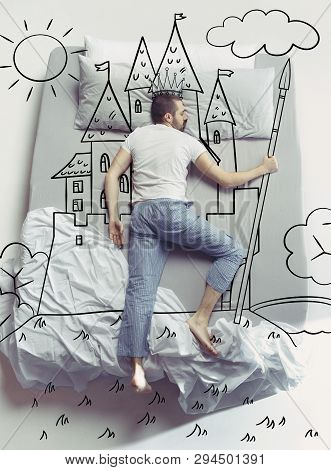 King Of The Family. Top View Photo Of Young Man Sleeping In A Big White Bed At Home. Dreams Concept.