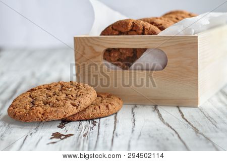 Box Of Fresh Homemade Oatmeal Cookies On A White Table Against A White Background.. Selective Focus