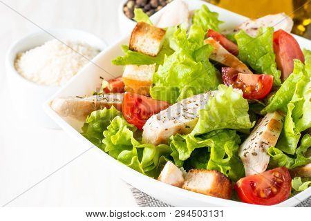 Fresh Salad Made Of Tomato, Ruccola, Chicken Breast, Eggs, Arugula, Crackers And Spices. Caesar Sala