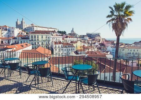 Street Cafe Table With City Skyline View. Lisbon, Alfama District, Portugal