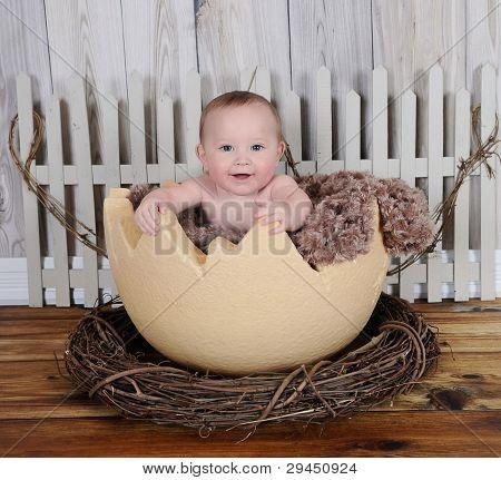 Happy Baby Sitting In Giant Egg Prop